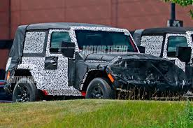 blue jeep 2 door spied 2018 jeep wrangler two door caught in the open motor trend