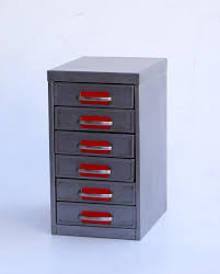 a warm home october polished metal drawers with bright red accents
