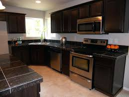 dark kitchen cabinets with gray walls black white counters wood