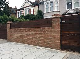 brick garden wall automatic gate hardwood screen london fulham