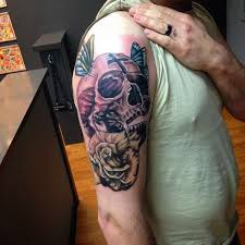 full color skull and rose tattoo sleeve for a man