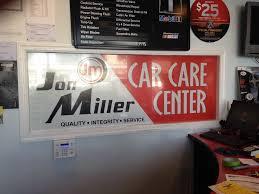 See Through Window Graphics Jon Miller Car Care Center Window Perforated Film Coastal Sign