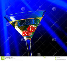 red dice in the cocktail glass on blue light casino concept stock
