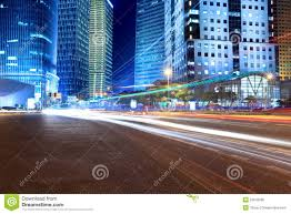 Modern City by Light Trails On The Modern City Street At Night Stock Photo