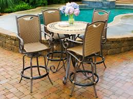 Round Stone Patio Table by Outdoor Round Wooden Dining Table With Chairs On A Concrete