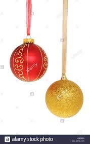 and gold baubles hanging from ribbons isolated against