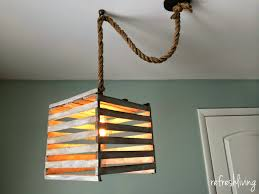 321 best lamp makeovers images on pinterest diy lamps lamp farmhouse light fixture from an old egg crate