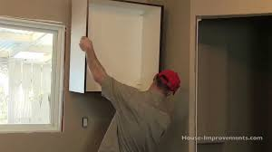 Install Wall Cabinets How To Install Kitchen Cabinets U2013 Youtube Throughout How To Hang