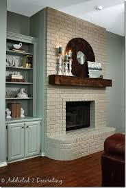 How To Update Brick Fireplace by How To Paint A Brick Fireplace Wood Mantle Brick Fireplace And