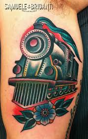 traditional old train engine with flower tattoo design for bicep