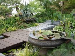 landscape art garden design with wooden pattern deck and garden
