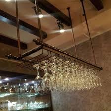image result for industrial wine glass hanging rack pub basement
