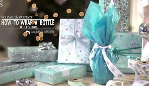 How To Wrap Gifts - woman wraps a bottle of sparkling wine in just 10 seconds on video