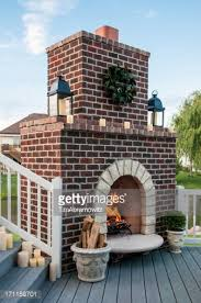 outdoor patio with fireplace chairs and barbeque grill stock photo