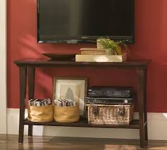 console table under tv tv mounted on wall with fireplace and table in bedroom google