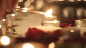 lights a candle lit candles petals defocusing stock