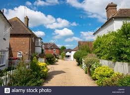 english british countryside cottages houses blue sky puffy clouds