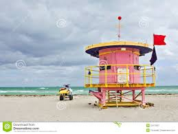 colorful pink lifeguard house in miami beach royalty free stock