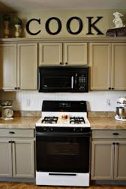 Top Of Kitchen Cabinet Decor Ideas Would Not Have Thought To Paint Cabinets This Color But I Think