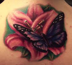 realistic lily flower with butterfly tattoo design for upper back