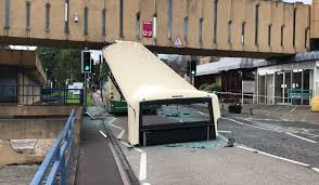 eight people injured after bus crashes into overhead walkway in