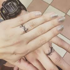 tattoos of wedding rings 1000 ideas about ring tattoo wedding on couples ring