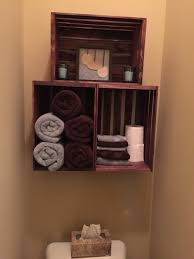 crate stacked shelves above toliet stacked crate shelve above