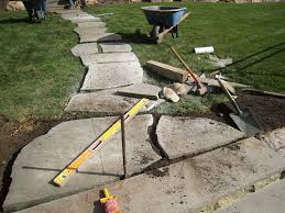 How To Make A Flagstone Patio With Sand How To Install A Flagstone Path In A Lawn Landscapeadvisor