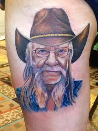 memorial colorful old man portrait tattoo on left side thigh
