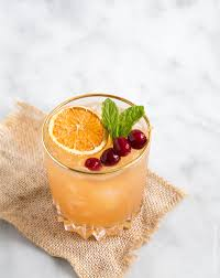 old fashioned cocktail garnish cranberry orange bourbon cocktail the little epicurean