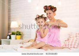 Fun In The Bedroom Mom Daughter Curlers Bedroom On Bed Stock Photo 613448183