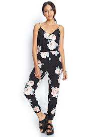 forever 21 rompers and jumpsuits lyst forever 21 satin floral jumpsuit in black