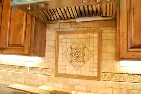 beautiful stone backsplash with medallion centerpiece artistic
