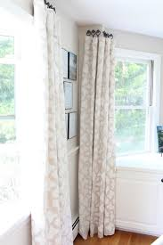 stenciled drop cloth curtain tutorial hang curtains window and room different way to hang curtains without a rod perfect for bay window