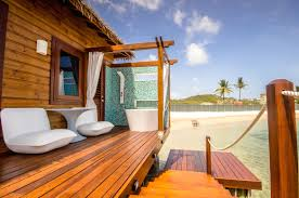 a luxury stay in an overwater bungalow at sandals grande st