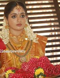 gold set for marriage kavya madhavan wedding jewellery south indian traditional