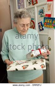 what to get an elderly woman for christmas elderly woman at christmas looking at holding some of