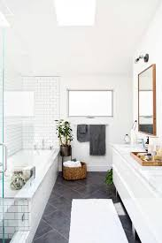 white ad wood bathroom design with white subway tile lauren