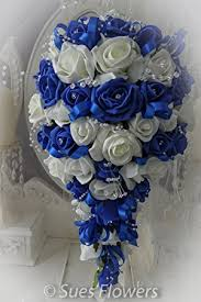 wedding flowers royal blue wedding flowers brides teardrop bouquet in royal blue and ivory