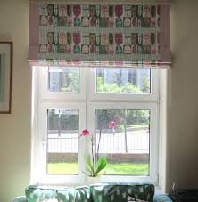 roman blind in vintage block print fabric with contrast border