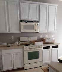 how to properly paint cabinets how to properly paint cabinets rust oleum cabinet