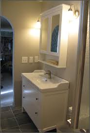 white cabinets in bathroom with victorian wood look tile benevola