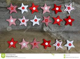 merry christmas decoration red and white fabric stars on rustic