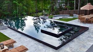 Infinity Pool Backyard by Custom Pool Design By Selective Designs