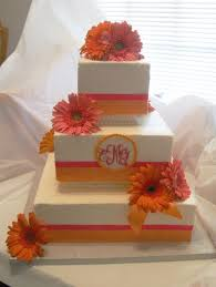unique square wedding cake with orange sunflowers stuff to buy
