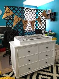 turquoise nursery design with yellow black and white accents