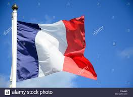 a french flag glowing o a blue sky stock photo royalty free image