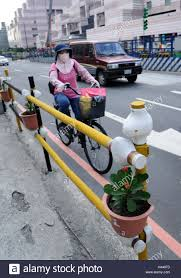 Banisters Flowers Cyclist Mask Street Railing Flowers Taipeh Taiwan Stock