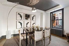 contemporary dining room with hardwood floors u0026 high ceiling in
