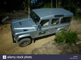 used land rover defender off roading silver metallic land rover defender 110 td5 by land